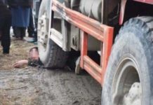 Crushed by truck, killed