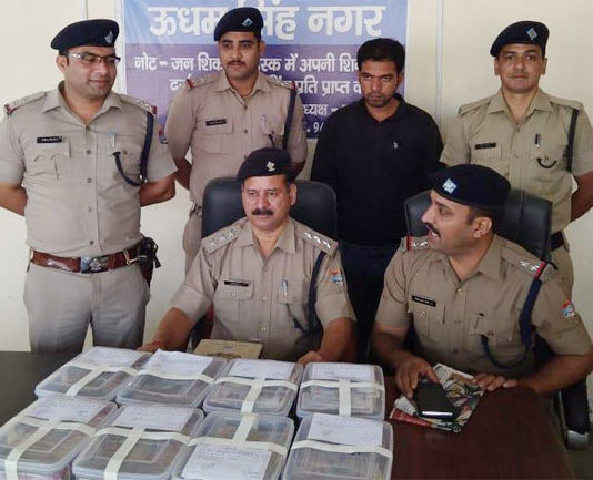 One arrested with 25 lakh cash and smack